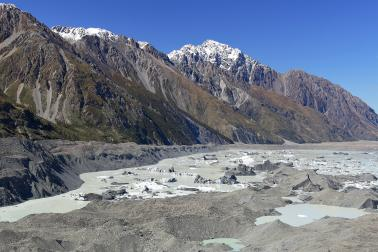Tasman Glacier covered with rock debris, Tasman Lake with icebergs and Tasman Valley. Liebig Range beyond. Aoraki/Mount Cook National Park, MacKenzie Dist., NZ.