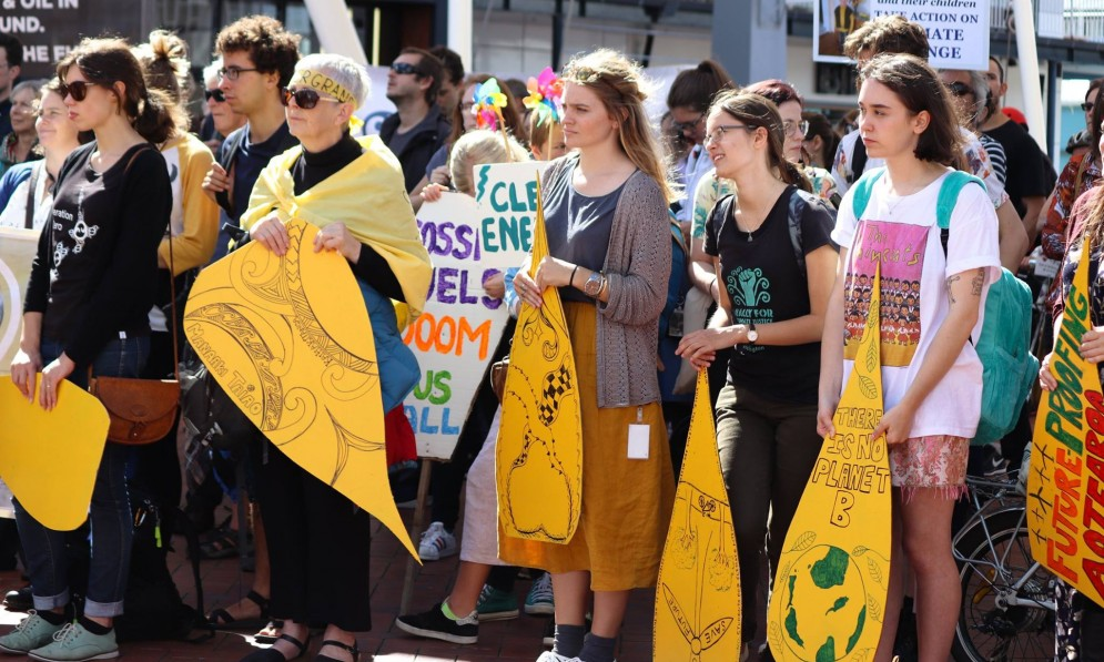 Forest & Bird Youth from Wellington stand in protest against oil.