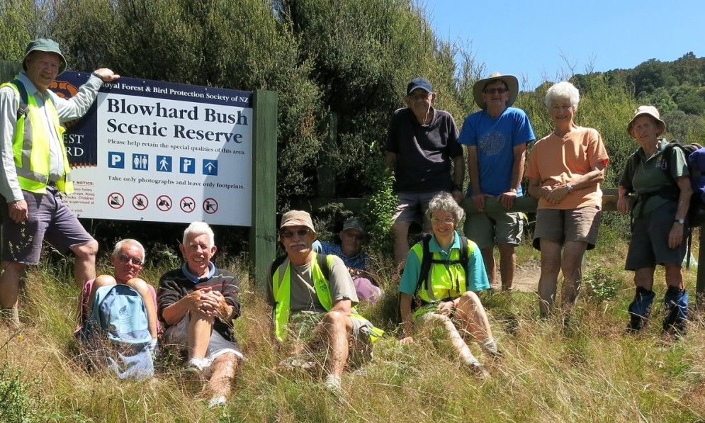 Volunteers standing by the Blowhard Bush Reserve sign