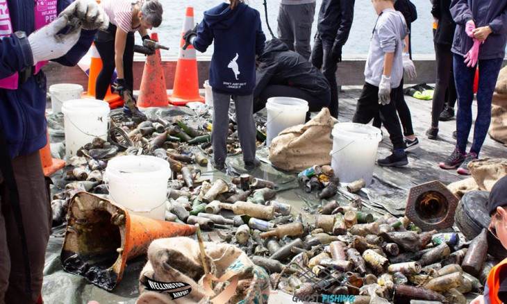 Photograph on bottles, road cones, and other rubbish collected from Wellington Harbour floor