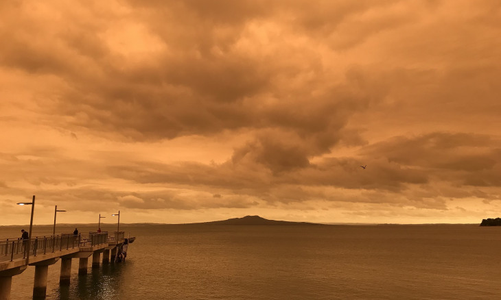 Smog from Australian bushfires turning the skyline over Rangitoto red
